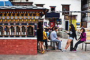 Teenage Bhutanese seen hanging around at the clock tower, the main square in Thimphu, Bhutan. Photo: Sanjit Das/Panos
