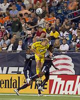 New England Revolution defender Cory Gibbs (12), Columbus Crew forward Steven Lenhart (32), and New England Revolution defender Emmanuel Osei (5) battle for head ball. The New England Revolution tied Columbus Crew, 2-2, at Gillette Stadium on September 25, 2010.
