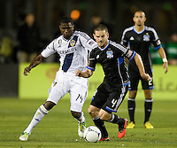 Sam Cronin of Earthquakes controls the ball away from Edson Buddle of Galaxy during the game at Buck Shaw Stadium in Santa Clara, California on November 7th, 2012.   LA Galaxy defeated San Jose Earthquakes, 3-1.