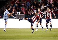 Chivas USA midfielder Nick LaBrocca (10) battles with Sporting Kansas City defender Roger Espinoza (15). Sporting KC defeated CD Chivas USA 3-2 at Home Depot Center stadium in Carson, California on Saturday March 19, 2011...
