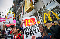 Student guestworkers and their supporters protest in front of a McDonald's restaurant in Times Square in New York on Thursday, March 14, 2013 against alleged exploitation of the international students by the fast food giant.  The workers allege that McDonald's used them as sub-minimum wage workers requiring them to work as long as 25 hours without overtime, charging exorbitant rates for housing in cramped conditions and retaliating against the J-1 guestworkers who complained, among other alleged abuses. (© Richard B. Levine)