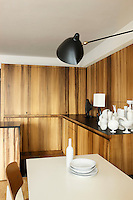 All appliances, utensils and crockery are hidden behind cupboards painted with a wood grain effect