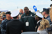 Magic Johnson greets service members attending the Quicken Loans Carrier Classic basketball game Friday, November 11, 2011 on the flight deck of the aircraft carrier USS Carl Vinson (CVN 70) in San Diego, California. Carl Vinson is hosting Michigan State University and the University of North Carolina for an NCAA basketball game..Mandatory Credit: Zachary Bell - U.S. Navy via CNP