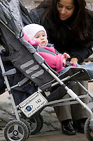 22 November 2006 - New York City, NY - Nanny B. Rodriguez looks after 13 month-old Vivienne Loigman whose stroller carries a Howsmynanny.com number plate in New York City, USA, 22 November 2006. The plate allows people to report any good or bad behaviour by the nanny to the website which then relays it to the parents.
