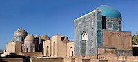 """Panoramic view of Mausoleums of the middle group, Shah-I Zinda Complex, Samarkand, Uzbekistan, pictured on July 19, 2010, in the early morning. The Shah-i-Zinda Complex is a necropolis of mausoleums whose legendary origin dates back to 676 when Kussam-ibn-Abbas arrived to convert the locals to Islam. So successful was he that he was assassinated whilst at prayer. His grave remains the centre of the sacred site which grew over many centuries, especially the 14th and 15th, into an architecturally stunning  example of ceramic art. From right to left: """"Nameless 1"""" Mausoleum, 1380s, created by Usto Alim Nesefi, the mausoleum is decorated  with relief painted majolica; the portal decorations are notable for the symbol of """"octagonal stars""""; to its left are 4 unknown Mausoleums; then another Mausoleum built in the 1380s, and on the extreme left, an octagonal pavilion with a high dome and lancet arches, built under Ulugh Beg. Samarkand, a city on the Silk Road, founded as Afrosiab in the 7th century BC, is a meeting point for the world's cultures. Its most important development was in the Timurid period, 14th to 15th centuries. Picture by Manuel Cohen."""