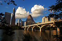 Kayakers enjoy the paddeling on the waters of Town Lake in as the Austin Skyline sits overview
