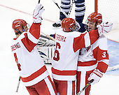 Adam Clendening (BU - 4) and Joe Pereira (BU - 6) celebrate Charlie Coyle's (BU - 3) hattrick. - The Boston University Terriers defeated the visiting University of Toronto Varsity Blues 9-3 on Saturday, October 2, 2010, at Agganis Arena in Boston, MA.