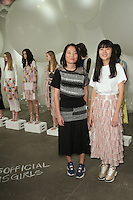 Fashion designers Wei Lin and Mijia Zhang pose in front of models at their PH5 Fall Winter 2017 collection fashion show, at Bortolami Gallery on 520 West 20th Street in New York City, on February 8, 2017; during New York Fashion Week: Women's Fall 2017.