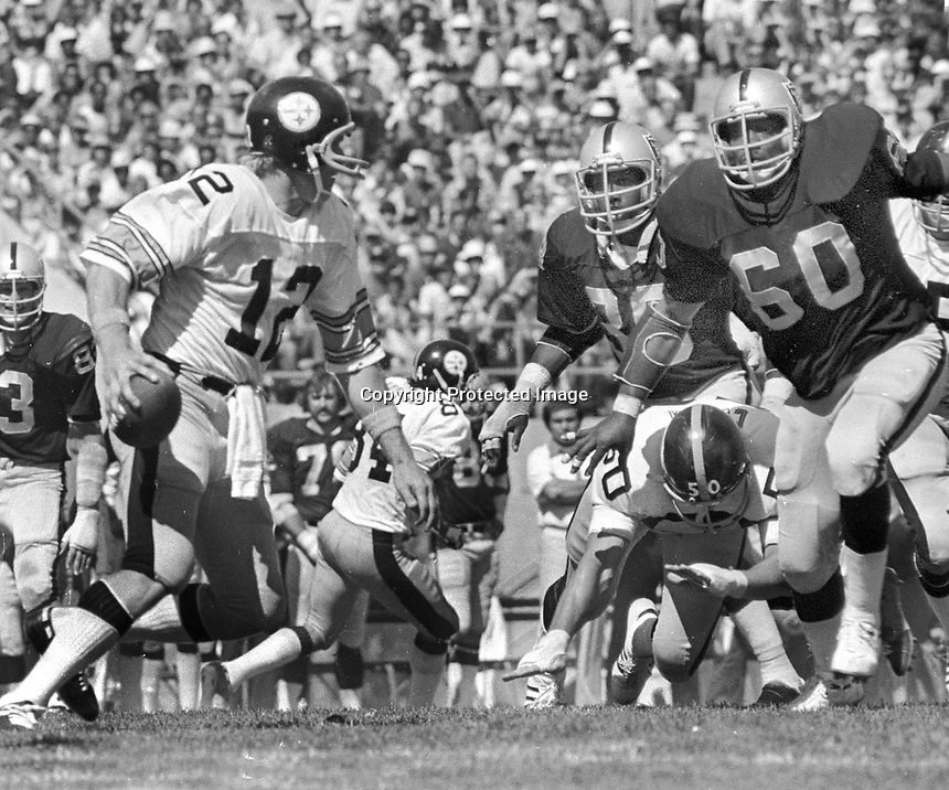 Oakland Raiders lineman #60 Otis Sistrunk puts rush on Steeler QB Terry Bradshaw. (1976 photo by Ron Riesterer)
