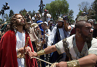 Christian Ramses Reyes portrays Jesus Christ as he is escorted by Roman soldiers during the Via Crucis in the neighborhood of Iztapalapa, April 14, 2006. Almost a million people attend the procession of Good Friday in this  neighborhood of Mexico City, where for o163 years the Iztapalapa neighborhood residents have taken part in a re-enactment of Christ's crucifixion.  Photo by © Javier Rodriguez
