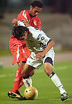 UNAM Pumas midfielder Fernando Morales (R) fights for the ball with  Brazilian International's forward Michel Neves during their qualifiying game for the Copa Libertadores at the University Stadium, March 8, 2006. International won 2-1 to UNAM Pumas. Photo by Javier Rodriguez