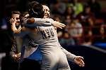 LA CROSSE, WI - MARCH 11: Nathan Pike of NYU is embraced after winning the 133 weight class during NCAA Division III Men's Wrestling Championship held at the La Crosse Center on March 11, 2017 in La Crosse, Wisconsin. Pike beat Albis with a fall to win the National Championship. (Photo by Carlos Gonzalez/NCAA Photos via Getty Images)