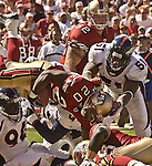 San Francisco 49ers running back Garrison Hearst (20) dives forward to make extra yards on Sunday, September 15, 2002, in San Francisco, California. The Broncos defeated the 49ers 24-14.