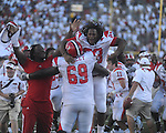 Jacksonville State linebacker Kevin Dix (23) and Jacksonville State defensive end Dimetrio Tyson (96) and Jacksonville State offensive lineman Tori Mobley (69)  celebrate their win at Vaught-Hemingway Stadium in Oxford, Miss. on Saturday, September 4, 2010. Jacksonville State won 49-48 in double overtime.