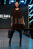 A model poses on the runway during the Elama fashion show held during the Fashion and Design Festival  in downtown Montreal.
