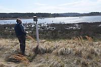 NWA Democrat-Gazette/FLIP PUTTHOFF <br />Ken Leonard of Bentonville, a Northwest Arkansas Master Naturalist, inspects one of several bluebird houses around the pond. The Master Naturalists take care of the houses and monitor nesting activity.