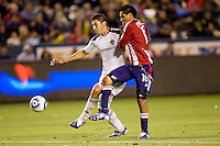 LA Galaxy defender Omar Gonzalez had a stellar holding up the defence as Chivas USA forward Jesus Padilla attempts to steal the ball. The LA Galaxy defeated Chivas USA 2-0 during the Super Clasico at Home Depot Center stadium in Carson, California Thursday evening April 1, 2010.  .