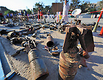 Months of fighting in Misrata, Libya, have left an abundance of ordnance scattered all over the city, some of which has been gathered by residents and placed in informal displays in front of buildings and in public spaces such as parks, including this public square. Yet these informal museums include some extremely dangerous unexploded ordnance, and an ordnance disposal team from the ACT Alliance is working with local residents and city officials to neutralize the threat posed to civilians by the war debris. ..