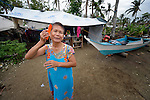 Princesita Llarenas, 72, combs her hair in front of her family's temporary shelter on Jinamoc Island, part of the municipality of Basey in the Philippines province of Samar that was hit hard by Typhoon Haiyan in November 2013. The storm was known locally as Yolanda. The ACT Alliance has been providing a variety of assistance to survivors here, and is planning a long-term rehabilitation program with residents.