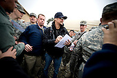 Bagram, Afghanistan - December 17, 2008 -- Grammy award winning musician Kid Rock signs autographs after performing at Bagram Air Base, Afghanistan during the 2008 USO Holiday Tour on Wednesday, December 17, 2008.  Tour host United States Navy Admiral Mike Mullen, chairman of the Joint Chiefs of Staff along with his wife Deborah welcomed comedians John Bowman, Kathleen Madigan and Lewis Black; actress Tichina Arnold; American Idol contestant and country musician Kellie Pickler on the tour bringing music and entertainment to service members and their families stationed overseas. .Credit: Chad J. McNeeley - DoD via CNP