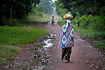 A woman in Riimenze, a village in Southern Sudan's Western Equatoria State, walks along a path on the first day of registration for the country's January 2011 referendum on secession from the north of the country.