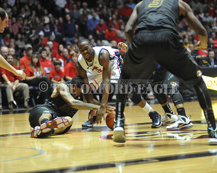 "Ole Miss' Jarvis Summers (32) vs. Missouri's Jabari Brown (32) at the C.M. ""Tad"" Smith Coliseum on Saturday, January 12, 2013. Ole Miss defeated #10 ranked Missouri 64-49."