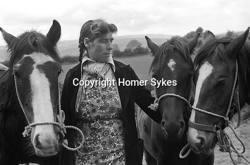 Appleby in Westmorland. 1981  <br /> A Roma woman in  apron and traditional neck scarf tied loosely around the neck, &lsquo;showing&rsquo; horses that are for sale