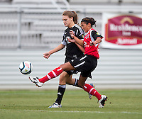 Ashley Herndon (19) of the D.C. United Women has the ball cleared away from her by Cheyenne Martinez-Trevino (5)) of the Virginia Beach Piranhas during the game at the Maryland SoccerPlex in Boyds, Maryland.  The D.C. United Women defeated the Virginia Beach Piranhas, 3-0, to advance to the W-League Eastern Conference Championship.