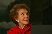 Washington, DC - June 2, 2009 -- Former first lady Nancy Reagan looks at United States President Barack Obama at the signing of the Ronald Reagan Centennial Commission Act in the Diplomatic Reception Room of the White House on Tuesday, June 2, 2009..Credit: Dennis Brack / Pool via CNP
