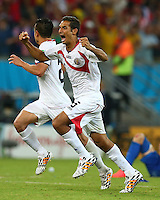 Celso Borges of Costa Rica celebrates winning the penalty shoot out