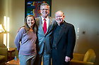 September 26, 2011; Nicole Garnett, professor of law and Rev. Timothy R. Scully, C.S.C., both co-chairs of the Forum Committee pose with Jeb Bush, Florida's former governor and founder of the Foundation for Excellence in Education before his talk at Leighton Concert Hall as part of the 2011-2011 Notre Dame Forum. Photo by Barbara Johnston/University of Notre Dame