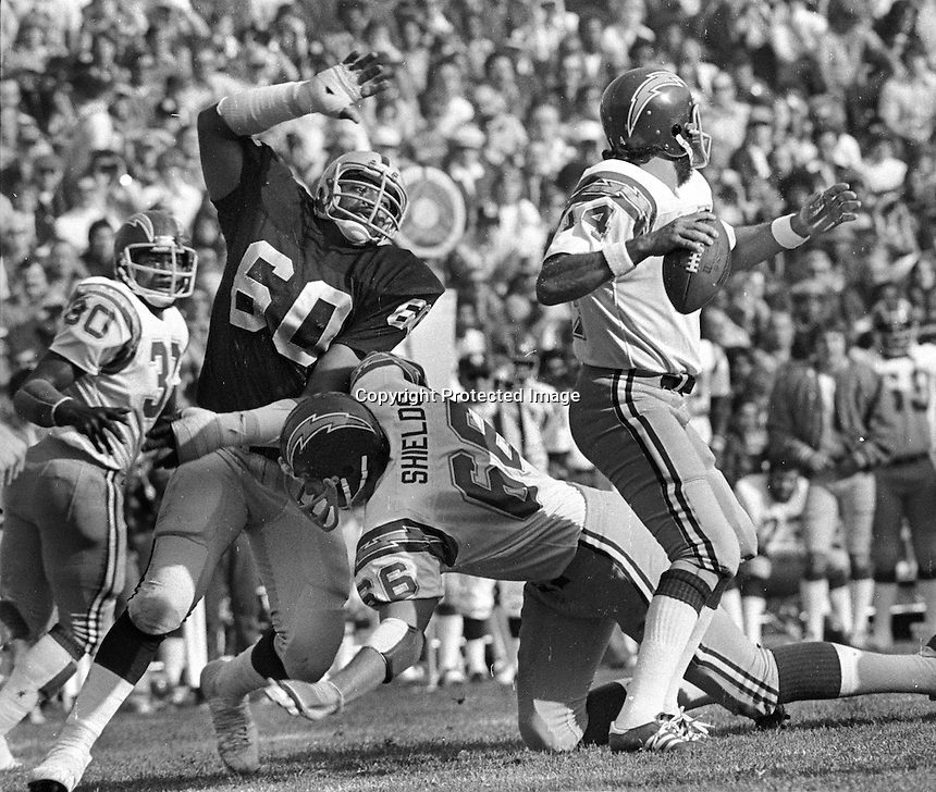 Oakland Raider Otis Sistrunk #60 after San Diego QB Dan Fouts, blocked by      Shields. (1976 photo/Ron Riesterer)