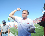 Ole Miss Head Coach Houston Nutt celebrates following the Rebels' win at Vaught-Hemingway Stadium in Oxford, Miss. on Saturday, October 2, 2010. Ole Miss won 42-35 to improve to 3-2..