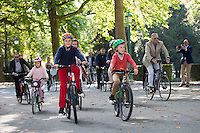 Royal Belgian family biking at the Sunday without car - Brussels