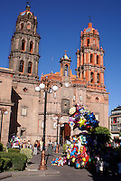 Balloon seller in front of the cathedral on the Plaza de Armas in the city of San Luis de Potosi, Mexico
