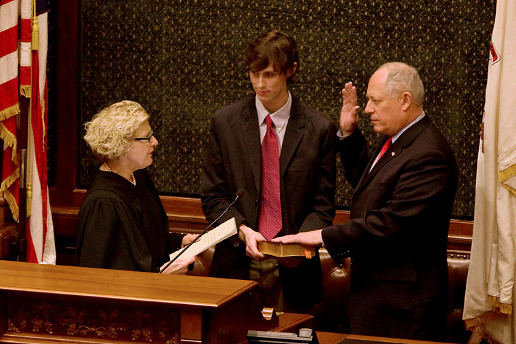 Illinois Lt. Gov. Pat Quinn, right, takes the oath of office to become the new Governor of Illinois as his son Pat Quinn IV, left, holds the bible at the State capitol in Springfield, Ill., on January 29, 2009. Quinn replaces former Gov. Rod Blagojevich after his impeachment.