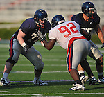 Ole Miss' Matt Hall (75) blocks during a team scrimmage at Vaught-Hemingway Stadium in Oxford, Miss. on Saturday, August 20, 2011.