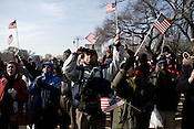 January 20, 2009. Washington, DC..Almost 2 million people packed the National Mall in sub freezing temperatures to witness the swearing in of Barack Obama, the 44th president of the united States and the first African American to hold the office. . Many waved flags and rejoiced as President Obama gave his inaugural speech.
