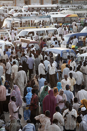 Crowds in Souq Al-Arabi, central Khartoum, Sudan, on Saturday, Apr. 14, 2007. The population of the city is approximately 8 million..Khartoum is modeling itself as the Dubai of Africa and despite Western sanctions the city is booming. Away from the troubles and poverty that plaque the rest of Sudan, development in Khartoum is moving at an astonishing rate. Investment from the East, and in particular China, allowed the Sudanese economy to grow by 11% in 2007. This growth is driven largely by oil, with production rising from 63,000 barrels per day in 1999 to over 500,000 barrels today.