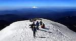 June 5, 2003 - Climbers pause near the summit for a panoramic view of the Cascade range including Mt. Jefferson and the Three Sisters. Mt. Hood climb to fight breast cancer, a benefit for the Fred Hutchinson Cancer Research Center.