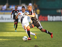 Kyle Porter (19) of D.C. United goes against Sean Franklin (5) of the Los Angeles Galaxy.  D.C. United tied the Los Angeles Galaxy 2-2, at RFK Stadium, Saturday September 14 , 2013.