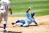 4 May 2011: #10 Tony Gwynn Jr.  slides into home plate and score the only run of the game for the Dodgers in the sixth inning. The Cubs defeated the Dodgers 5-1 during a Major League Baseball game at Dodger Stadium in Los Angeles, California.  Dodgers players are wearing Brooklyn Dodger 1940's throwback jersey uniforms and the Chicago Cubs are also wearing throwback retro jersey uniforms. **Editorial Use Only**