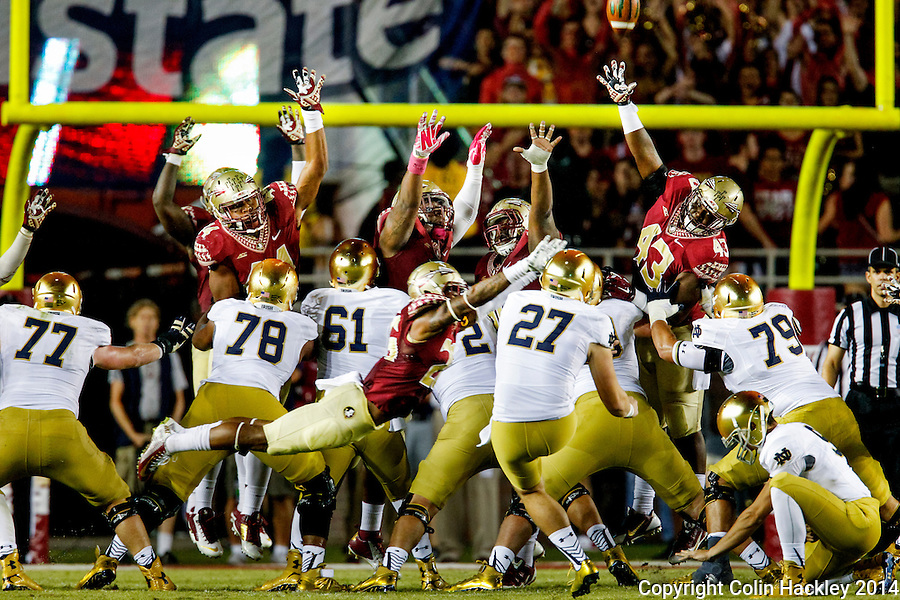 TALLAHASSEE, FLA. 10/18/14-FSU-ND101814CH-Florida State defenders attempt to block Notre Dame's field goal near the end of first half action Saturday at Doak Campbell Stadium in Tallahassee. <br /> COLIN HACKLEY PHOTO