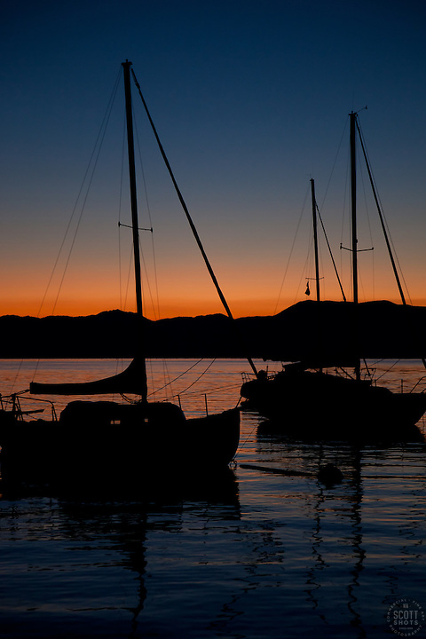 """Tahoe Sailboats at Sunrise"" - These silhouettes of sailboats were photographed at sunrise on Lake Tahoe."