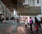 People at the World Press Photo Exhibition, Oude Kirk, Amsterdam