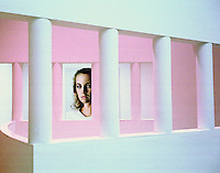 A painting on the wall of the Frankfurt Museum of Modern Art is seen through two sets of pillars.
