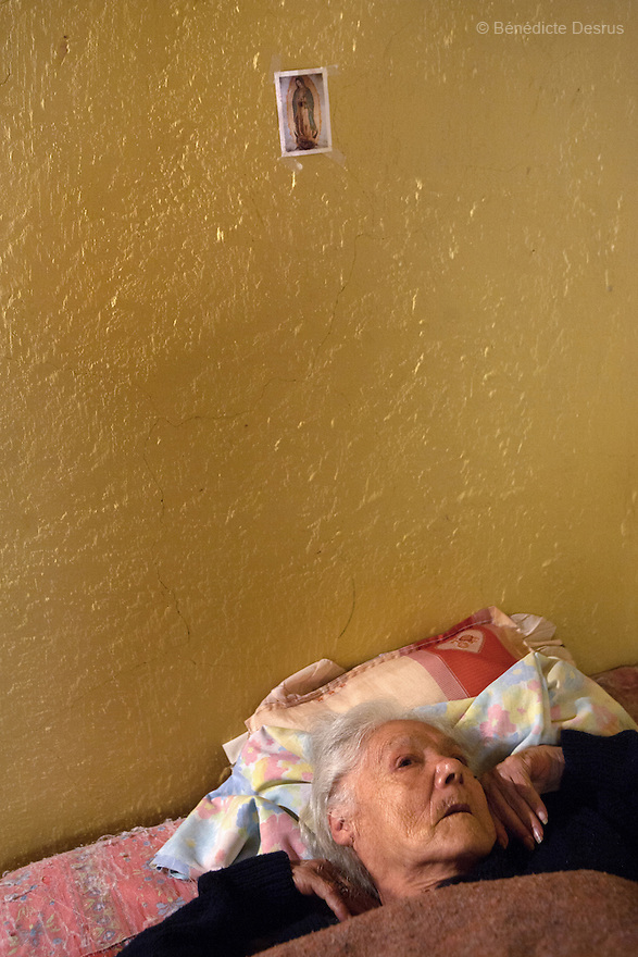 Consuelo, a resident of Casa Xochiquetzal, lies in her bed as she is sick at the shelter in Mexico City, Mexico on July 22, 2008. Casa Xochiquetzal is a shelter for elderly sex workers in Mexico City. It gives the women refuge, food, health services, a space to learn about their human rights and courses to help them rediscover their self-confidence and deal with traumatic aspects of their lives. Casa Xochiquetzal provides a space to age with dignity for a group of vulnerable women who are often invisible to society at large. It is the only such shelter existing in Latin America. Photo by Bénédicte Desrus