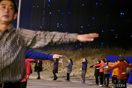 Landless farmers practise group exercise on an urban area built over their farmland in Hubei province on the outskirt of Beijing.<br /> <br /> China is pushing ahead with a dramatic, history-making plan to move 100 million rural residents into towns and cities over six years &mdash; but without a clear idea of how to pay for the gargantuan undertaking or whether the farmers involved want to move.<br />