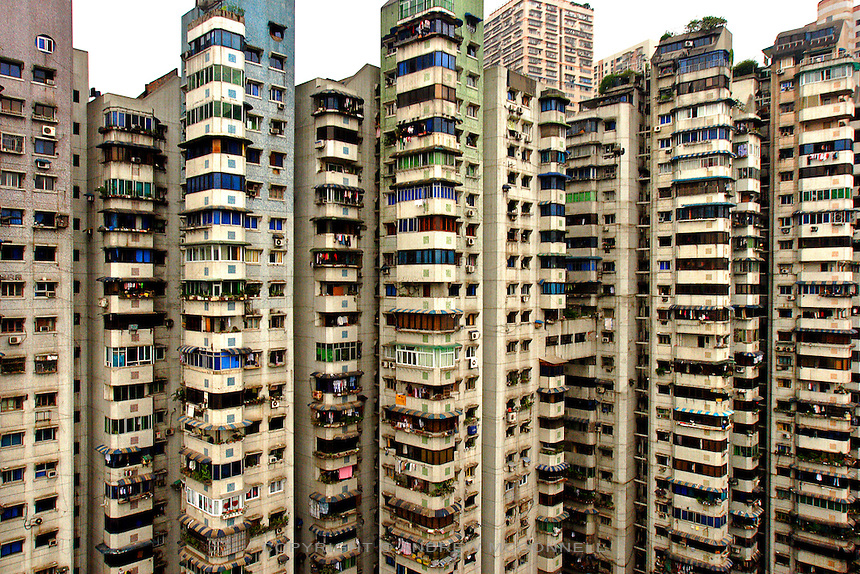 Apartment blocks tower over the sprawling metropolis of Chongqing in western China. Perched on the banks of the mighty Yangtze River, Chongqing has grown to become China's third largest city with a population of 12 million, however, with the entire population of the Chongqing Municipality at 32 million, some analysts put it as the largest city in the world.