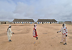 Girls skip rope in front of their school in the Dereig Camp for internally displaced persons.